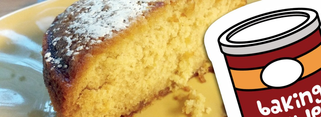 A photograph showing half of a plain yellow cake sprinkled with powdered sugar sitting on a yellow dish. An illustration of a red baking powder canister is superimposed on the image.